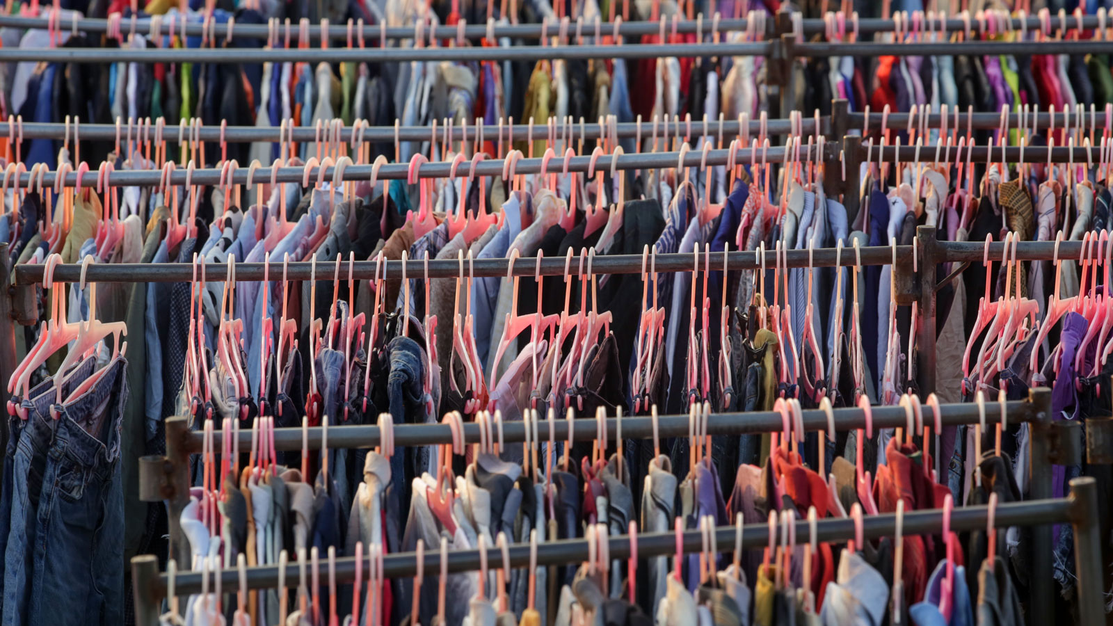 Racks of clothing.  Image by triocean via Shutterstock